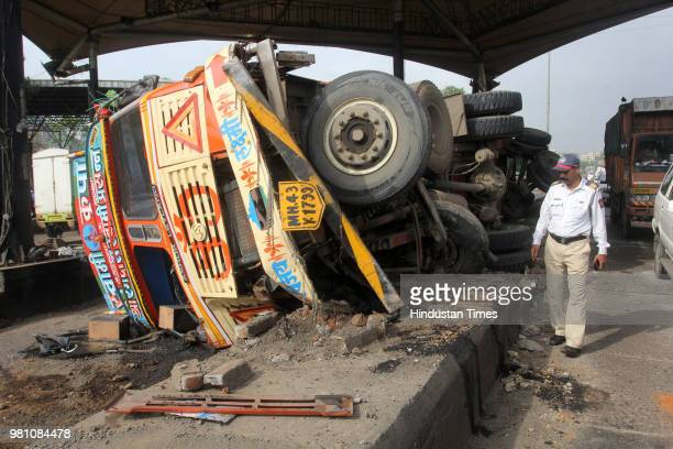 An oil container toppled down on road near Kharegaon toll naka Thane on June 21 2018 in Mumbai India Police officials Regional Disaster Management...