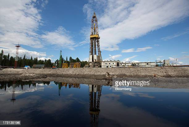 An oil derrick operated by Salym Petroleum stands in a drilling location in Salym KhantyMansi autonomous region Russia on Tuesday July 2 2013 Gazprom...