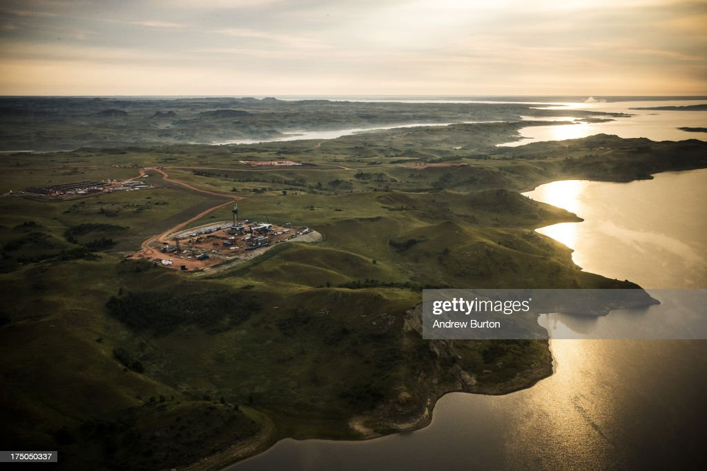 An oil drilling rig is seen in an aerial view in the early morning hours of July 30, 2013 near Bismarck, North Dakota. The state has seen a boom in oil production thanks to new drilling techniques including horizontal drilling and hydraulic fracturing.