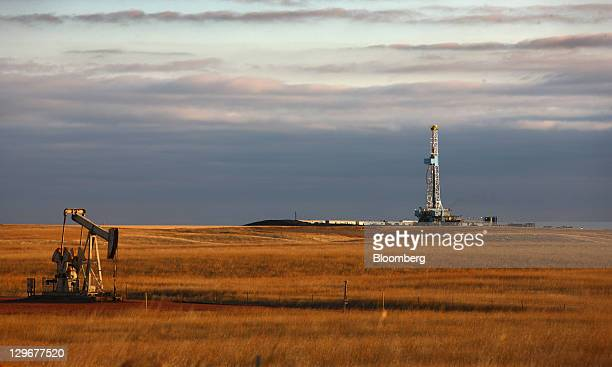 An oil drilling rig stands on the Bakken formation in Watford City North Dakota US on Friday Oct 14 2011 Oil production in the state has tripled in...