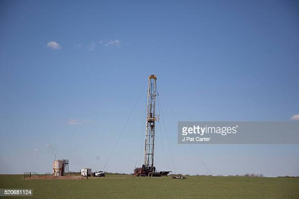 An oil field crew drills a fracking well March 31 2016 near Crescent Oklahoma The United States Geological Survey estimates that more than 7 million...