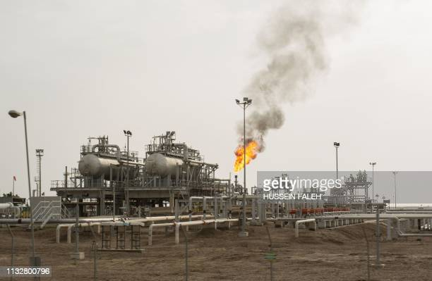 An oil installation is pictured in the massive Majnoon oil field some 40 kms from the eastern border with Iran north of the Iraqi city of Basra on...