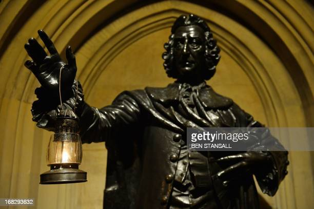 An oil lamp hangs on a statue of William Pitt Earl of Chatham in the Prince's Chamber as Yeomen of the Guard prepare to conduct a ceremonial search...