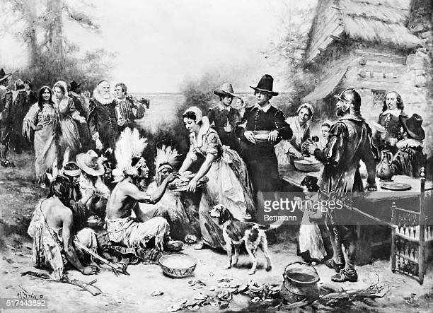 An oil painting by Jean LG Ferris of the first Thanksgiving A pilgrim woman serves a Native American food Undated illustration