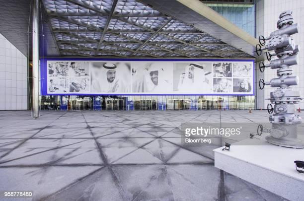 An oil pipeline control head sits on display near photographs of Sheikh Khalifa bin Zayed Al Nahyan United Arab Emirates' president and ruler of Abu...