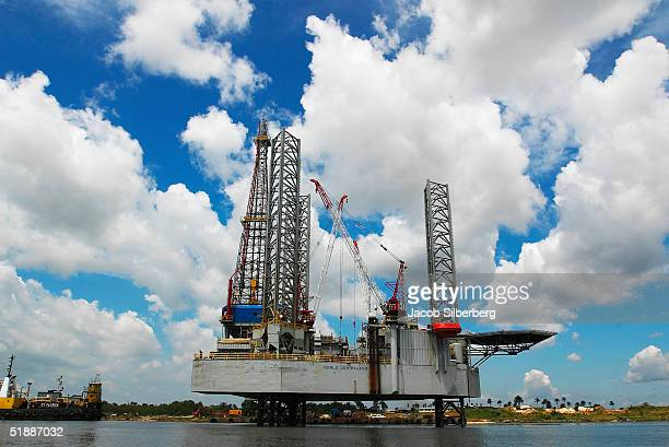 An oil platform owned by the Texas company Noble Energy is positioned along a creak October 9 2004 near Port Harcourt Nigeria A member of OPEC...
