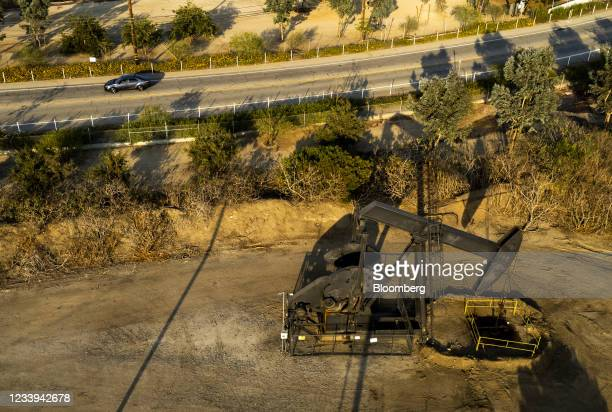An oil pump jack operates at the Inglewood Oil Field in Culver City, California, U.S., on Sunday, July 11, 2021. Oil dipped after a two-day gain as...