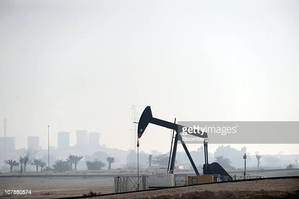 An oil pump operates in the Awali oil field in Bahrain on Wednesday Jan 5 2011 Oil extended its biggest drop in seven weeks on signs that snowstorms...