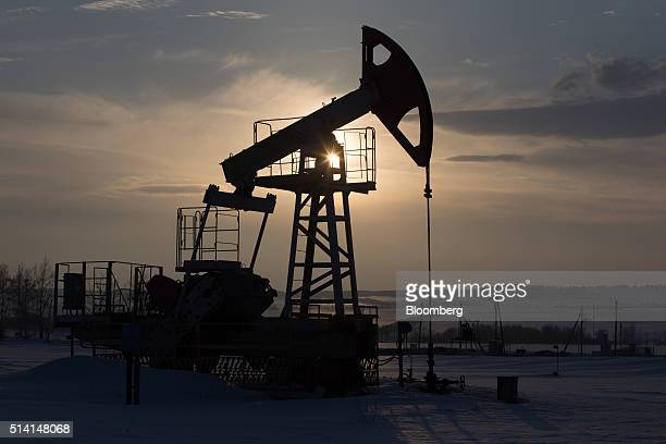 An oil pumping jack also known as a 'nodding donkey' stands in an oilfield operated by Bashneft PAO in the village of Otrada 150kms from Ufa Russia...