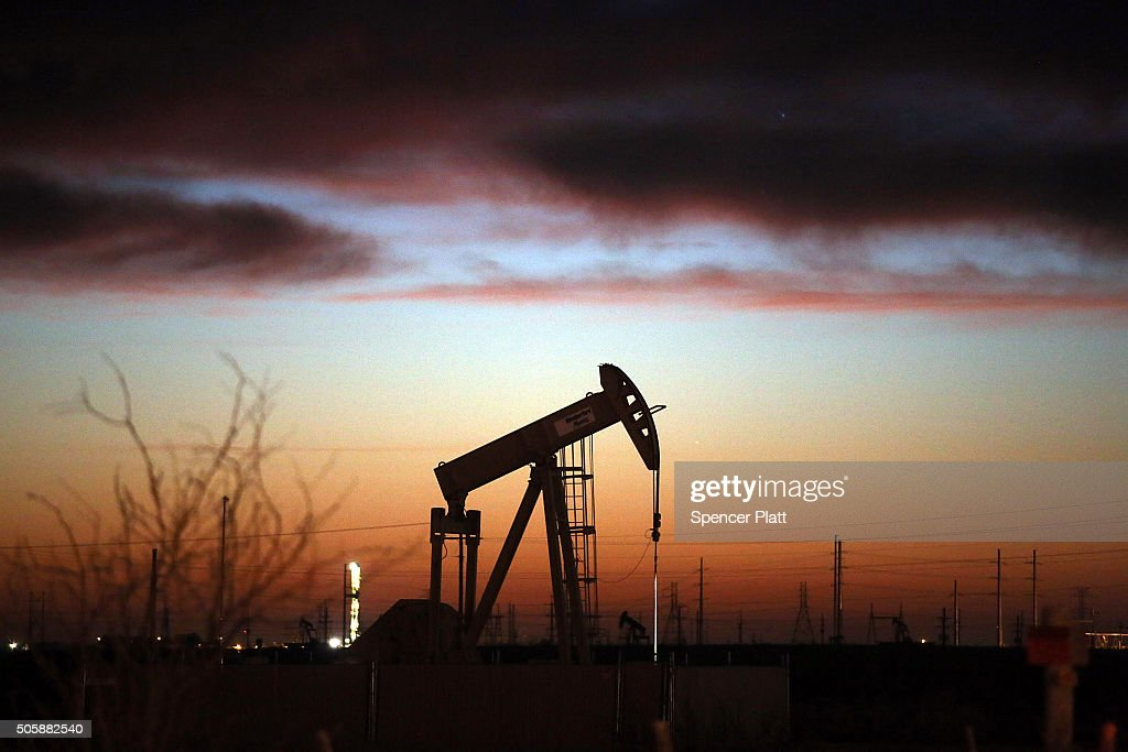 An oil pumpjack works at dawn in the Permian Basin oil field on January 20, 2016 in the oil town of Andrews, Texas. Despite recent drops in the price of oil, many residents of Andrews, and similar towns across the Permian, are trying to take the long view and stay optimistic. The Dow Jones industrial average plunged 540 points on Wednesday after crude oil plummeted another 7% and crashed below $27 a barrel.