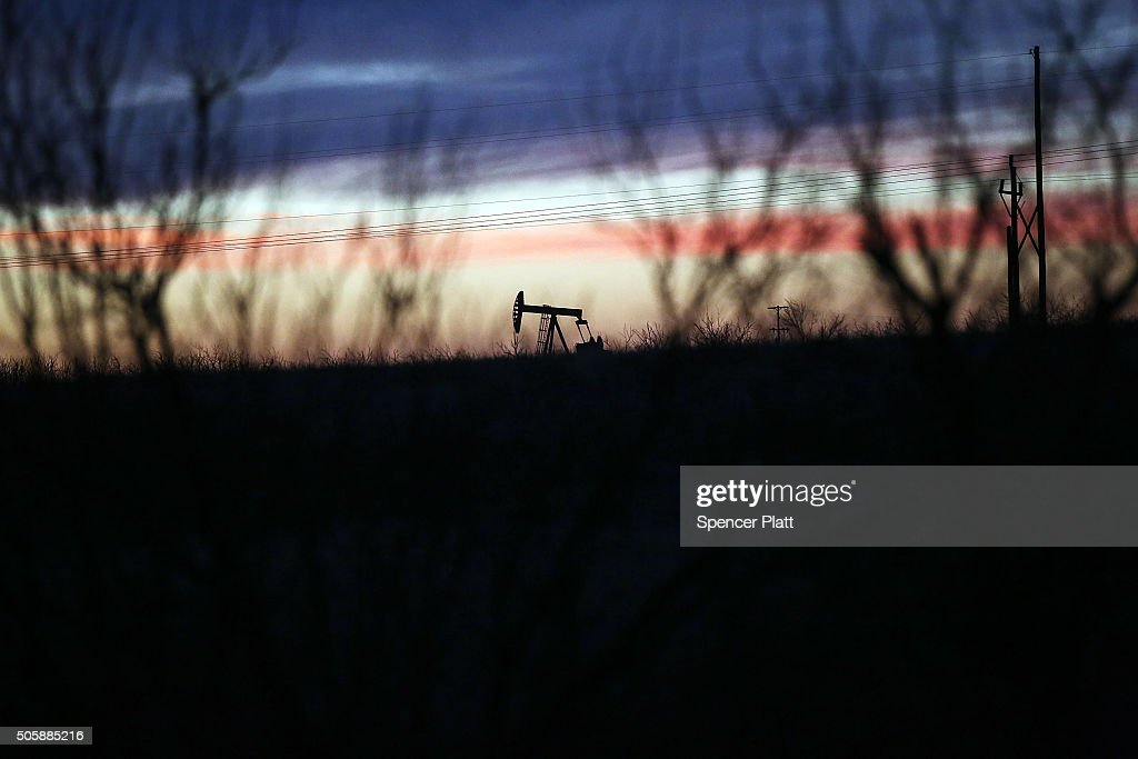 An oil pumpjack works at dawn in the Permian Basin oil field