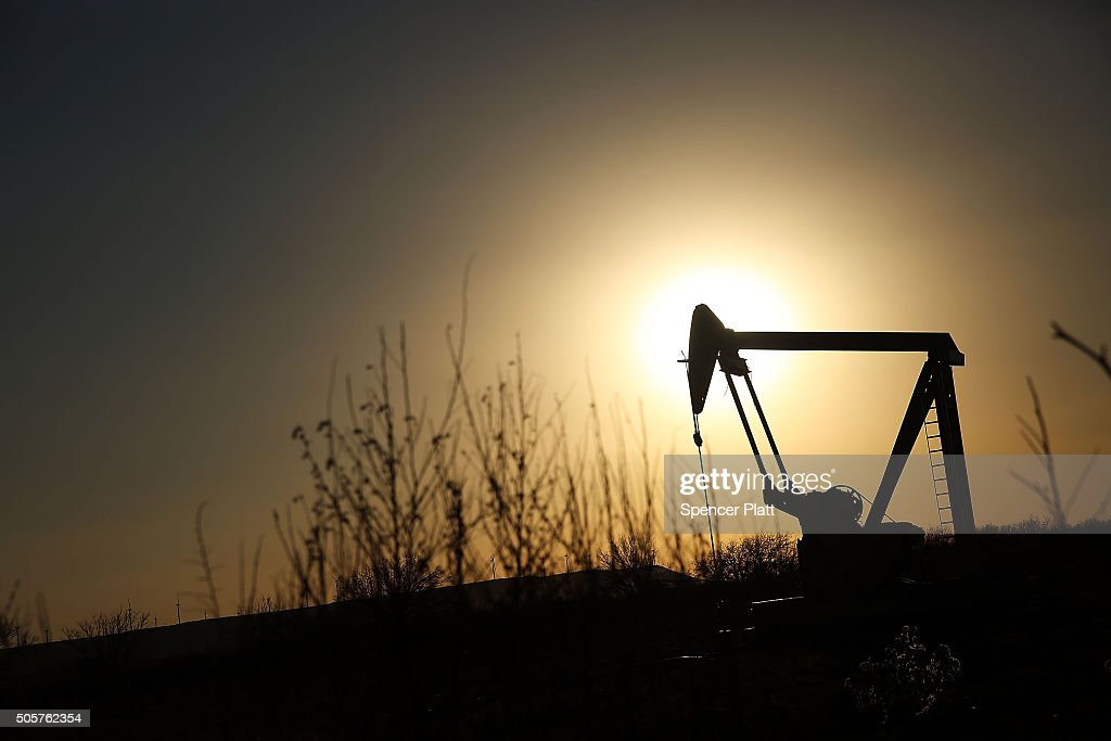 An oil pumpjack works on January 19, 2016 in Sweetwater, Texas. Global oil prices continue their downward fall with U.S. oil dropping towards $27 a barrel, its lowest since 2003, on worries about global oversupply. Following a diplomatic agreement on nuclear fuel with America, Iran has forecast it will add 500,000 barrels per day to global production, following the lifting of sanctions.