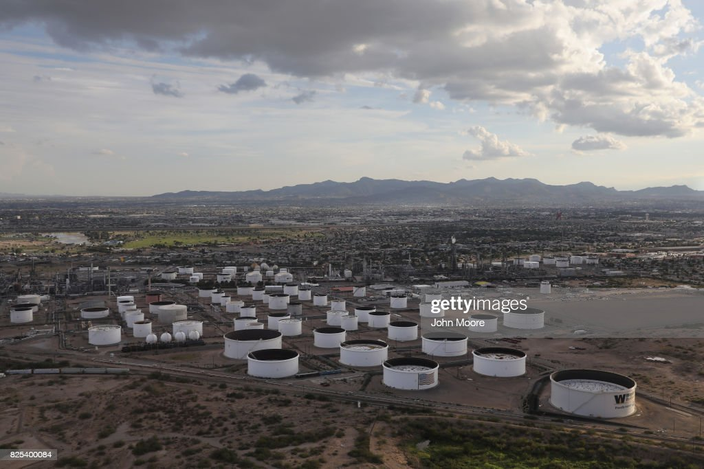An oil refinery and tanks stand near the U.S.-Mexico border on August 1, 2017 in El Paso, Texas. San Antonio based Tesoro purchased Western Refining in June, renaming the combined companies Andeavor.