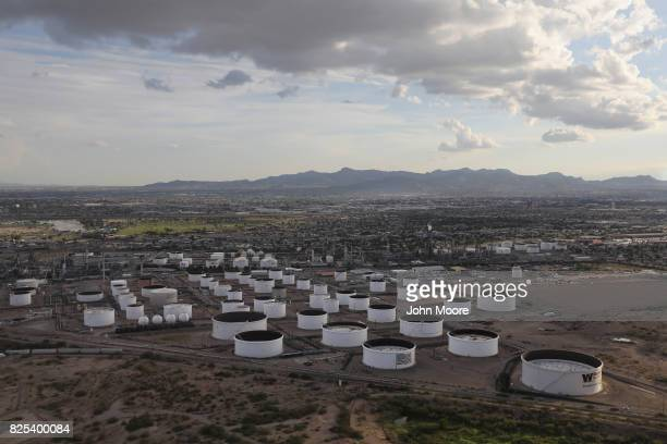 An oil refinery and tanks stand near the USMexico border on August 1 2017 in El Paso Texas San Antonio based Tesoro purchased Western Refining in...