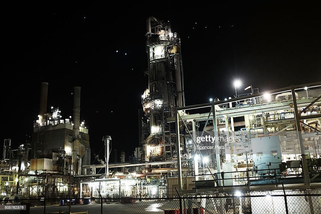 An oil refinery is lit up in the night on January 19, 2016 in Big Spring, Texas. Global oil prices continue their downward fall with U.S. oil dropping towards $27 a barrel, its lowest since 2003, on worries about global oversupply. Following a diplomatic agreement on nuclear fuel with America, Iran has forecast it will add 500,000 barrels per day to global production, following the lifting of sanctions.