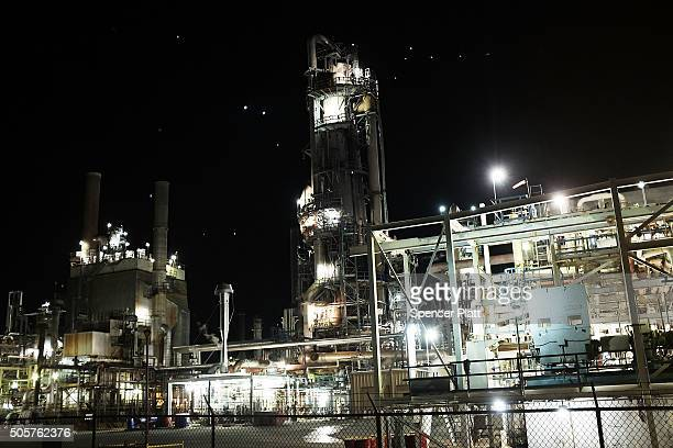 An oil refinery is lit up in the night on January 19 2016 in Big Spring Texas Global oil prices continue their downward fall with US oil dropping...
