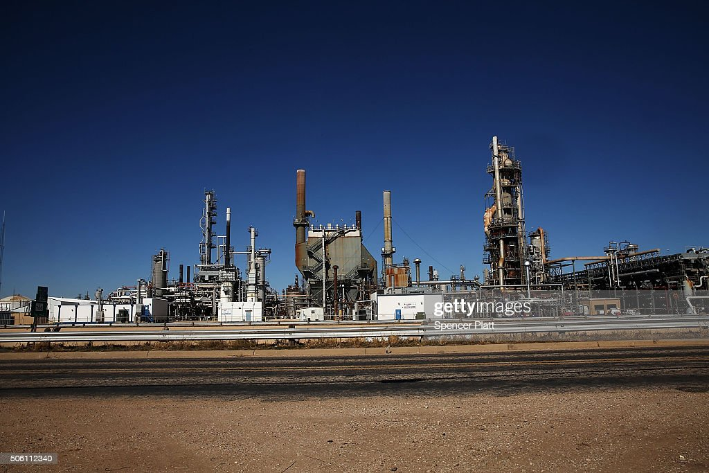 An oil refinery is situated along a highway on January 21, 2016 in Big Spring, Texas. Global oil prices continue their downward fall with U.S. oil dropping towards $27 a barrel, its lowest since 2003, on worries about global oversupply. Following a diplomatic agreement on nuclear fuel with America, Iran has forecast it will add 500,000 barrels per day to global production, following the lifting of sanctions.