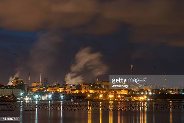 An oil refinery operates in a coastal agricultural site on March 10 2016 in Taranto Apulia Italy A national referendum on oil drilling brought about...