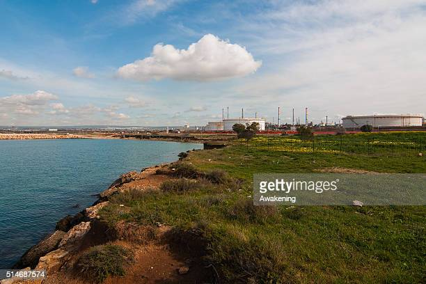 An oil refinery operates near the center of the city on March 10, 2016 in Taranto, Apulia, Italy. A national referendum on oil drilling, brought...