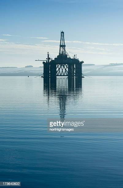 An oil rig in the middle of a body of water