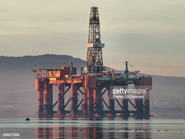An oil rig moored in the Cromarty Firth, with a faint mist. A Scottish Highland winter scene.