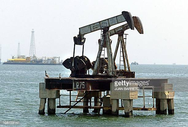 An oil rig sits in the sea near Maracaibo 500km from Caracas 03 May 2003 Venezuelas oil industry suffers from the country's political unrest and...
