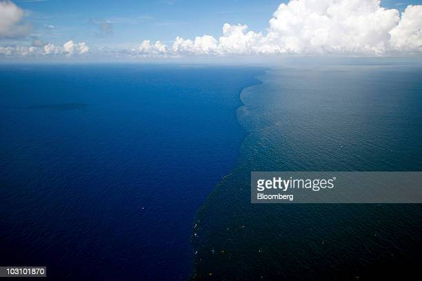 An oil sheen and clumps of oil are seen in the Gulf of Mexico off the coast of Louisiana US on Monday July 26 2010 BP Plc returned to work on...
