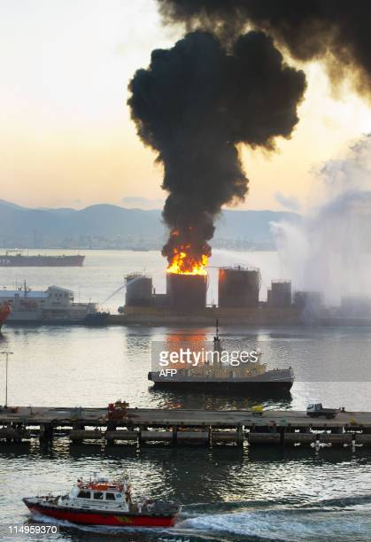 An oil tank explodes in the port of Gibraltar on May 31 2011 'Independence of the Seas' cruise ship which was nearby has pulled out to sea for safety...