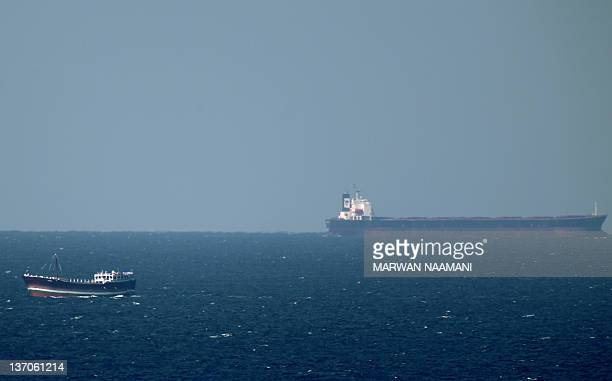 An oil tanker cruises towards the Strait of Hormuz off the shores of Khasab in Oman on January 15 2011 Iran threatened to close the Strait of Hormuz...