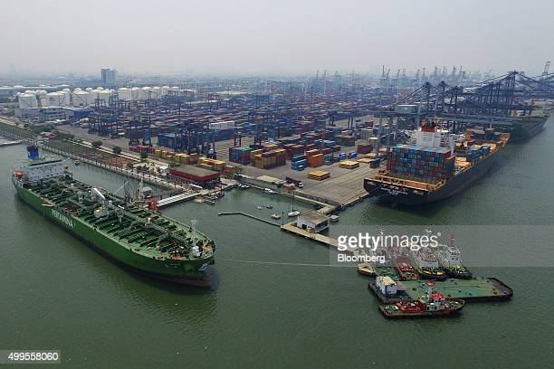 An oil tanker left sits docked at a PT Pertamina facility at Tanjung Priok Port in this aerial photograph taken in Jakarta Indonesia on Monday Nov 30...