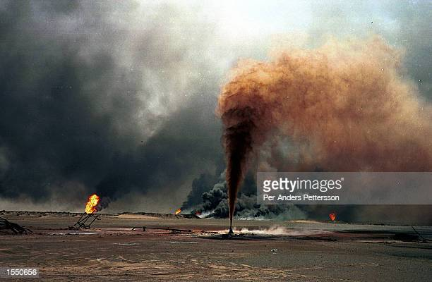 An oil well blown up by Iraqi forces as they left Kuwait during the end of the Gulf War burns August 10 1991 at the Greater Burhan oilfield in Kuwait...