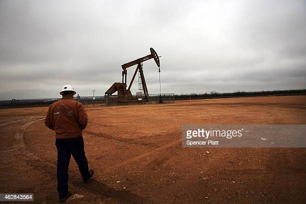 An oil well owned an operated by Apache Corporation in the Permian Basin are viewed on February 5 2015 in Garden City Texas The well produces about...