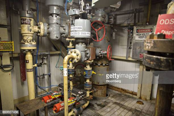 An oil wellhead stands in a well house at the Caelus Energy LLC Oooguruk Development Project in Harrison Bay Alaska US on Friday Feb 17 2017 Four...