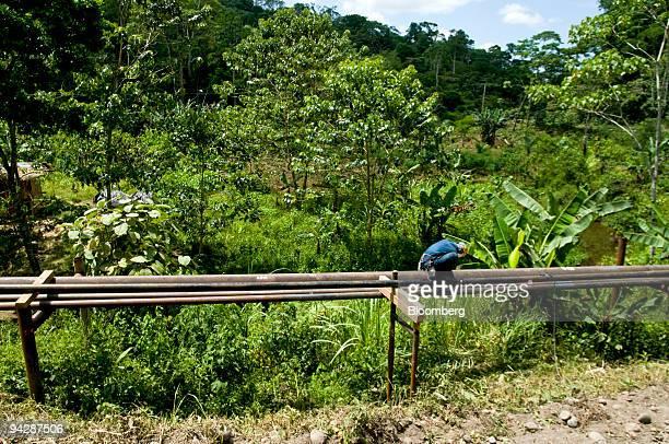 An oil worker repairs an oil pipeline near Yasuni National Park in Orellana Province Ecuador on Tuesday Oct 13 2009 Ecuador is seeking about $3...