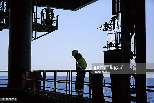 An oil worker stands aboard the Casablanca oil platform operated by Repsol SA in the Mediterranean Sea off the coast of Tarragona Spain on Tuesday...