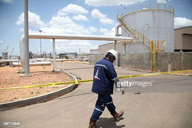 An oil worker walks in an oil production facility in Paloch in South Sudan's Upper Nile state on May 5 where South Sudan's Minister for Petroleum and...