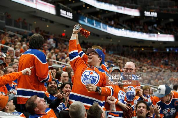 An Oilers fan shows off the puck he caught that went out of play as the Edmonton Oilers take on the Anaheim Ducks in Game Four of the Western...