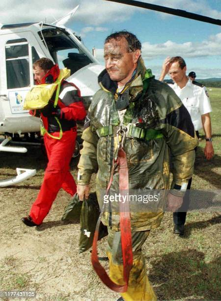 An oilsoaked survivor from the stricken yacht Business Post Naiad arrives in Merimbula 28 December after being winched aboard a rescue helicopter...