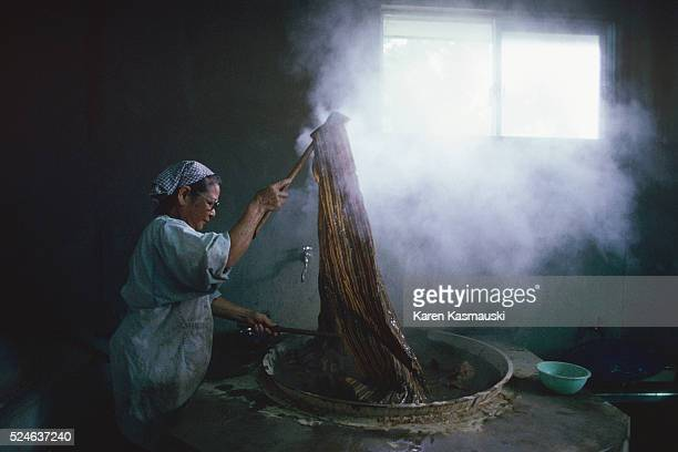 An Okinawan woman processes cloth made from the leaf of banana plants The cloth called Bashofu is highly prized