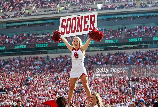 An Oklahoma Sooners cheerleader performs during the game against the Kansas State Wildcats October 15 2016 at Gaylord FamilyOklahoma Memorial Stadium...