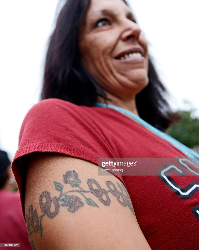 An Oklahoma Sooners fan shows her OU tattoos before the game against the Tulsa Golden Hurricane September 19, 2015 at Gaylord Family-Oklahoma Memorial Stadium in Norman, Oklahoma.