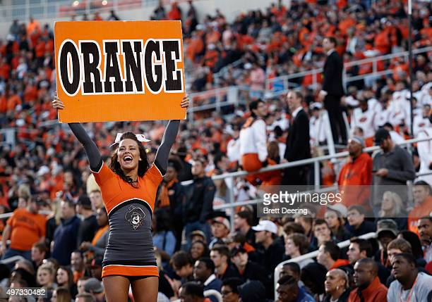 An Oklahoma State Cowboys cheerleader performs during the game against the TCU Horned Frogs November 7 2015 at Boone Pickens Stadium in Stillwater...