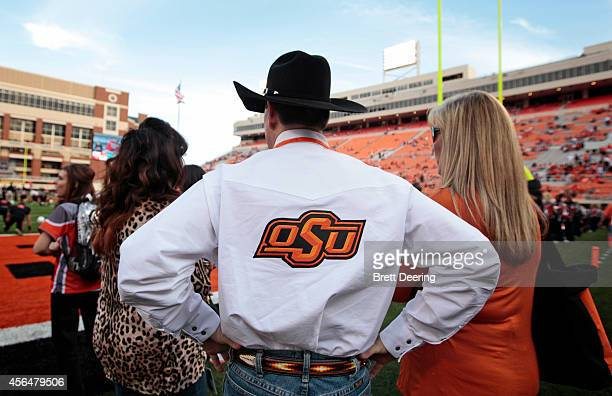 An Oklahoma State Cowboys fan is seen on the sidelines before the game against the Texas Tech Red Raiders September 25 2014 at Boone Pickens Stadium...