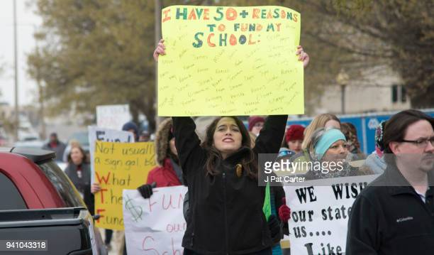 An Oklahoma teacher walks the picket line at the state capitol on April 2 2018 in Oklahoma City Oklahoma Thousands of teachers and supporters are...