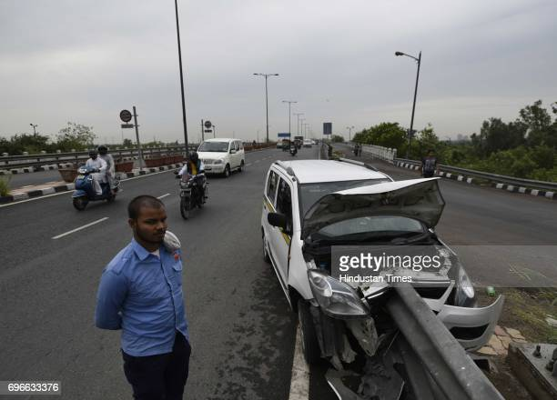 An Ola car meets with an accident as the driver of the cab was trying to save a biker during the heavy rain at Gita Colony Flyover on June 16 2017 in...