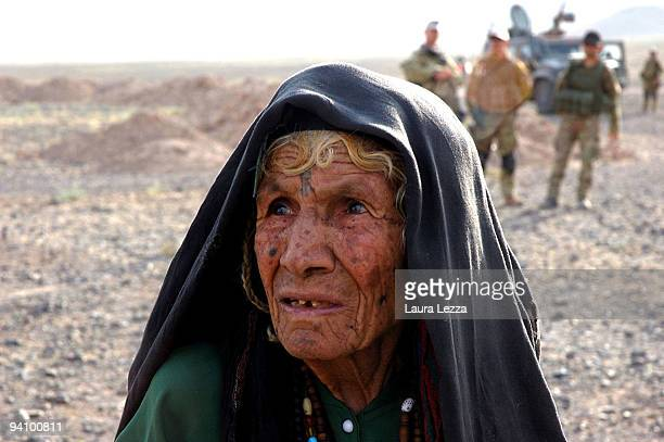 An old afghan woman while soldiers of the Folgore Parachute Brigade visit a small and remote village on September 16 2009 off the city of Shindand...