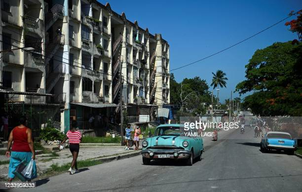 An old American car drives along a street of La Ginera in Arroyo Naranjo Municipality in Havana, on July 13, 2021. - Cuban authorities have cut...