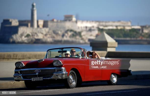An Old American car drives along the Malecon in Havana on January 26 2017 Cuba is in style since there was an approach in its relationship with the...