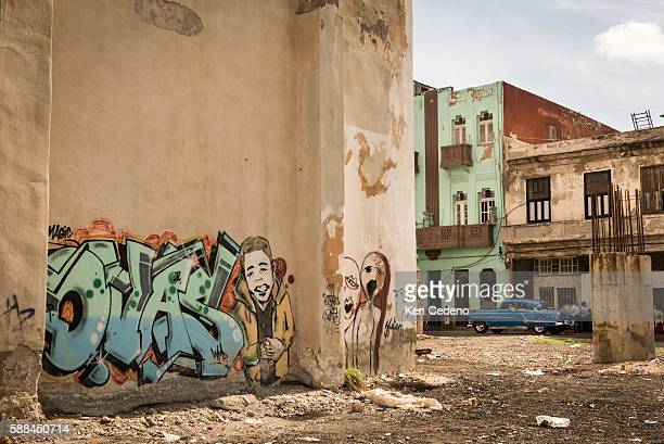 An old American car from the 50's drives east on San Lazaro street near a building covered with graffiti in Havana Cuba January 2 2015 Many of the...