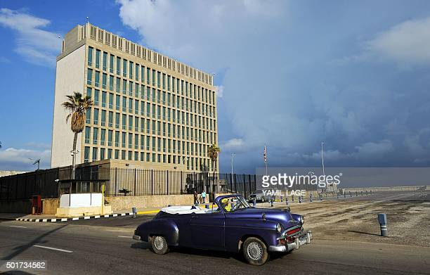 TOPSHOT An old American car passes by the US Embassy in Havana on December 17 2015 The United States announced Thursday the resumption of regular...